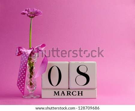 Pink theme, save the date white block calendar for International Women's Day, March 8, decorated with flower, vase and polka dot ribbon. - stock photo