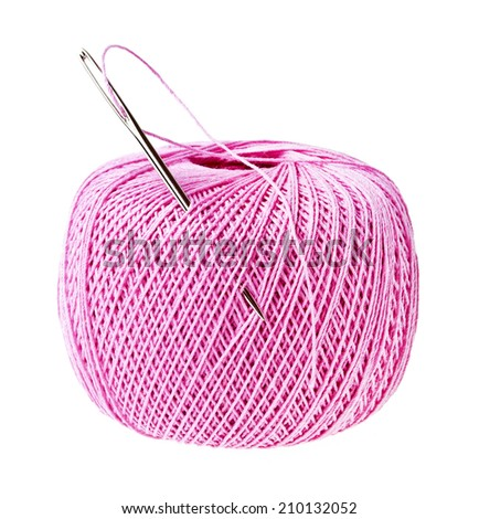 Pink thread ball and needle with thread isolated on white background - stock photo