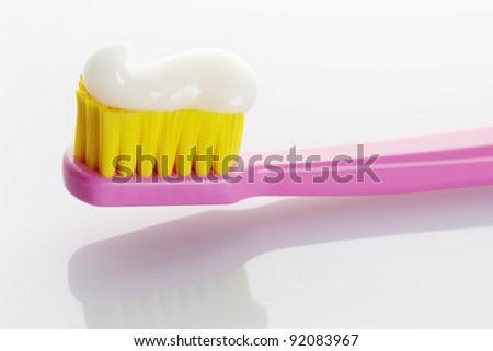 Pink Toothbrush with Toothpaste Isolated on White Background - stock photo