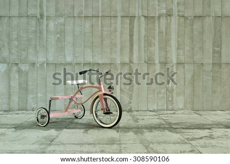 pink tricycle on concrete - stock photo