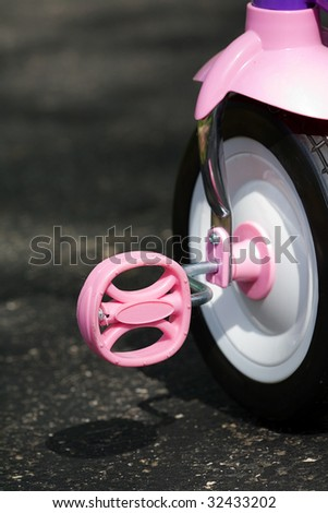 pink tricycle pedal - stock photo