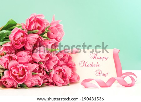 Pink tulips and greeting card with sample text Happy Mother's Day! - stock photo