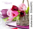 Pink tulips and pink album on a white background. With sample text. - stock photo