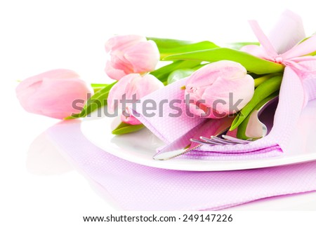 pink tulips in a plate, on a white background. romantic still life with fresh flowers - stock photo