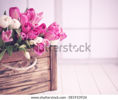 Pink tulips over white wood table  - stock photo