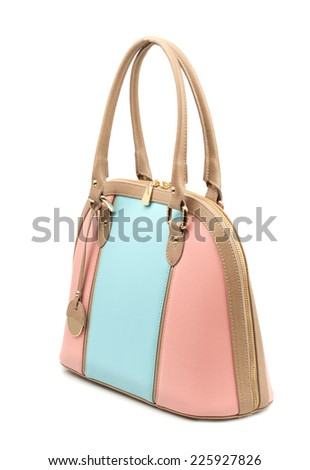 Pink-turquoise female bag isolated on white background.