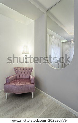 Pink upholstered chair in living room  - stock photo