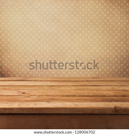 Pink vintage background with wooden deck table - stock photo