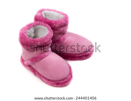 Pink warm fur boots. Isolate on white background. - stock photo