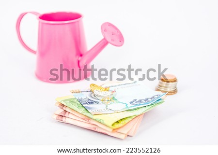 pink watering can with money   (path in side) isolate on white ,Interpretive to money investment , glow up money - stock photo
