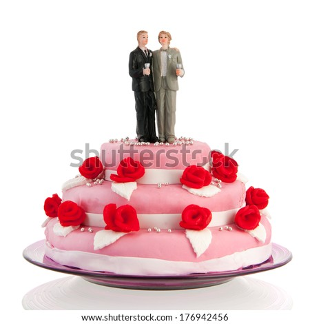 Pink wedding cake with red roses isolated over white background - stock photo
