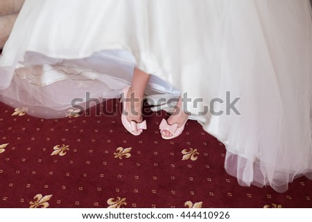 Pink Wedding shoes on the feet of the bride - stock photo