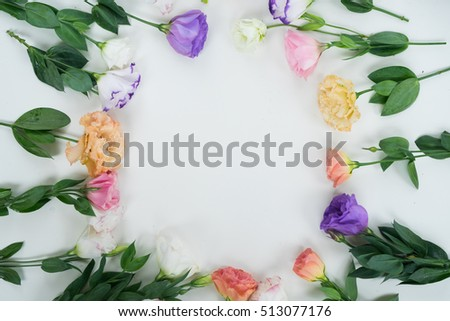 Pink, white and violet eustoma flowers frame