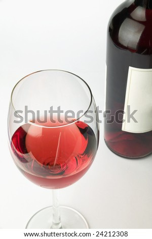 Pink wine and the bottle - stock photo