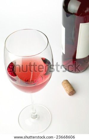 Pink wine the cork and the bottle isolated on white - stock photo