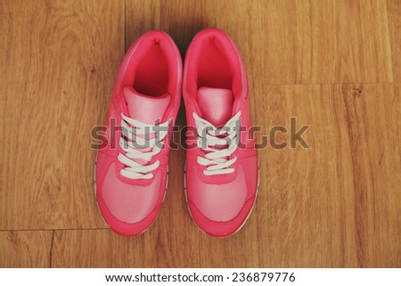Pink woman sport shoes. Photo toned style instagram filters.  - stock photo