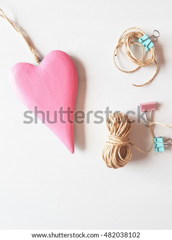 pink wooden heart with rope and clips,concept love