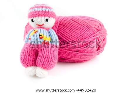 Pink wool ball with homemade knitted doll isolated on white background - stock photo