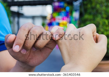 pinky swear or reconcile - stock photo