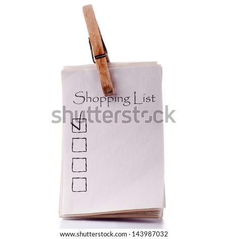 Pinned shopping list isolated on white background. Handmade retro style concept - stock photo