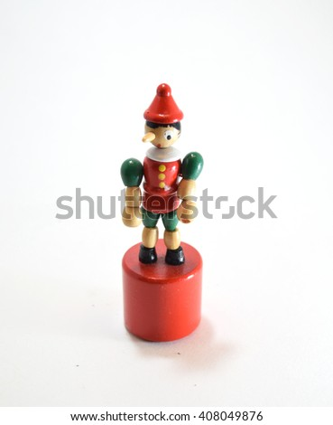 Pinocchio elastic wooden doll with retractable arms and legs - stock photo