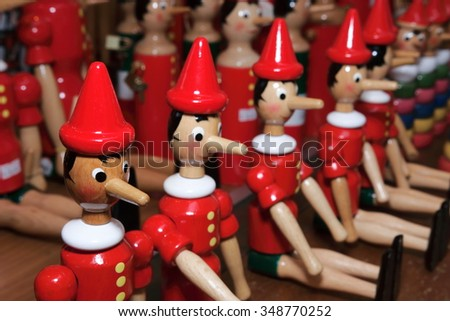 Pinocchio wooden puppet from the book written by Carlo Collodi Italy - stock photo