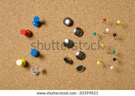 Pins and tacks on a cork board - stock photo