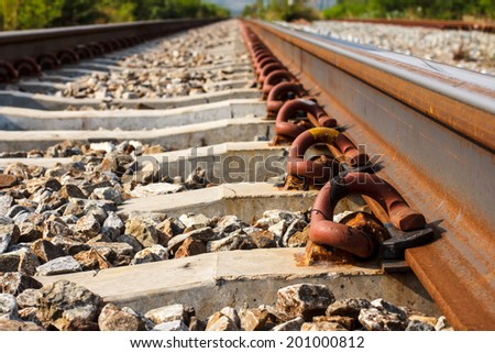 Pins steel firmly attached to the rails railroad. - stock photo