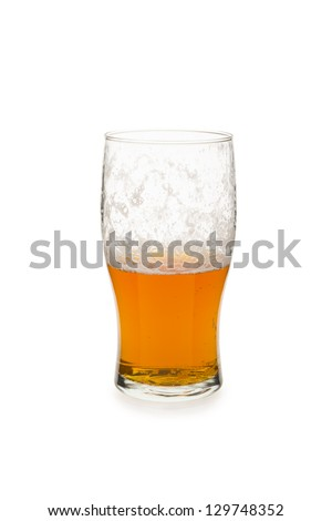 Pint glass half empty isolated against white background. - stock photo