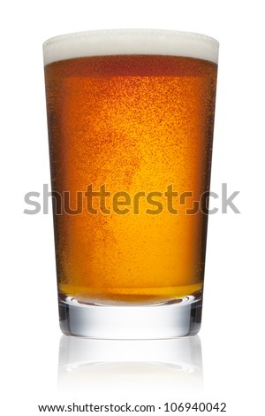 Pint glass of refreshing amber beer with bubbles and head - stock photo