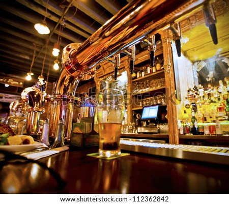 https://thumb9.shutterstock.com/display_pic_with_logo/79547/112362842/stock-photo-pint-of-beer-on-a-bar-in-a-traditional-style-pub-112362842.jpg