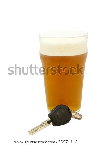 Pint of beer with a set of keys on a white background - stock photo