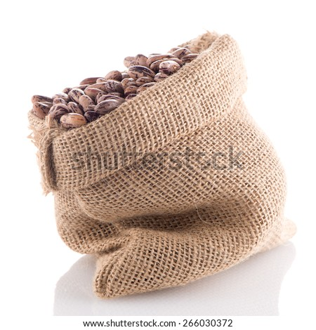 Pinto beans bag on white background.