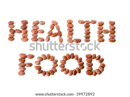 Pinto beans spelling the words HEALTH FOOD isolated against white