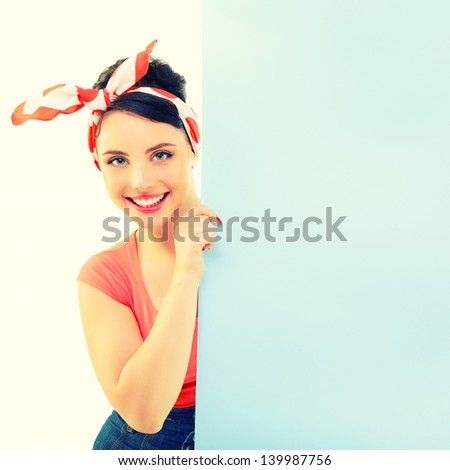 Pinup girl holding empty banner, portrait of young happy sexy woman in pin-up style, toned - stock photo