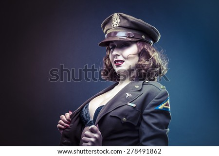 pinup girl in sexy clothes era of World War II - stock photo