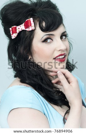 Pinup model wearing bow in hair head shot