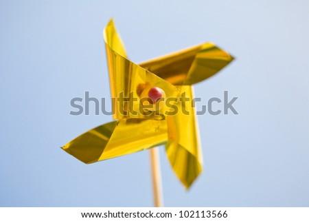 pinwheel against blue background - stock photo