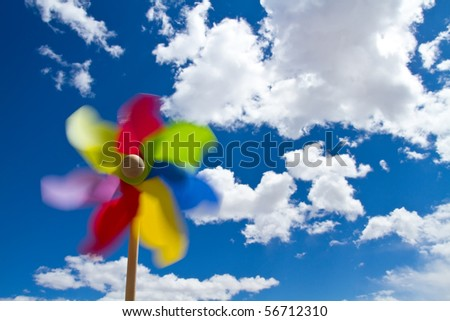 Pinwheel for clean energy concept on blue sky with white clouds