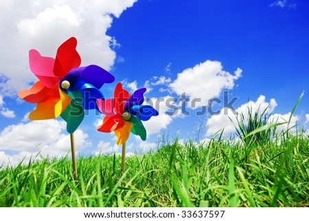 Pinwheels on Meadow at Sunny Day - stock photo