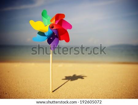 Pinwheels on the beach. - stock photo