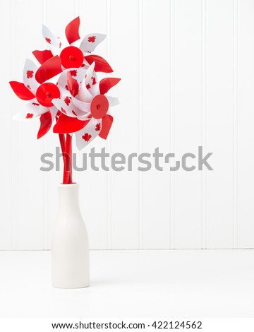 Pinwheels with a Canadian motif arranged in a vase like flowers. - stock photo