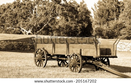 Pioneer wagon in a field.  Fayette State Historical Park.  Garden, Michigan.  - stock photo