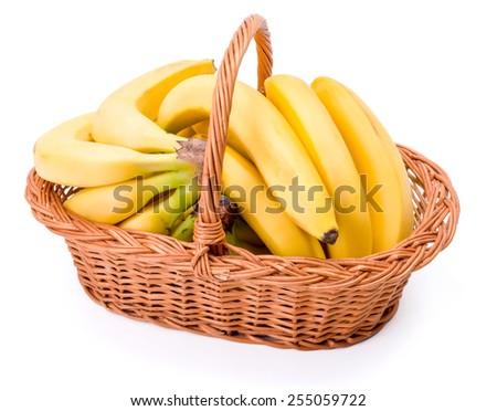 Pipe bananas in wicker basket. Musa acuminata - stock photo