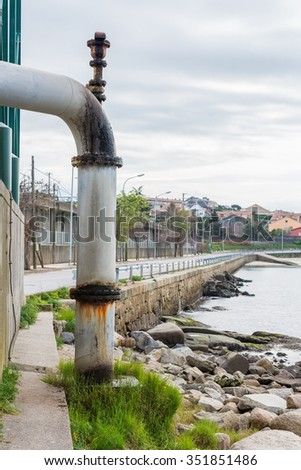 pipe for draining sewage into the ocean - stock photo