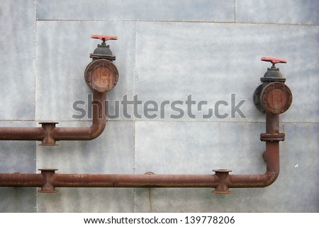 pipe on the wall - stock photo