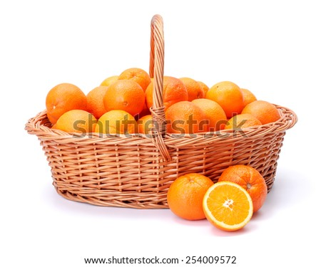 Pipe oranges in wicker basket. Citrus sinensis