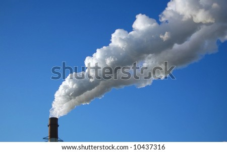 Pipe, smoke on a background blue sky.