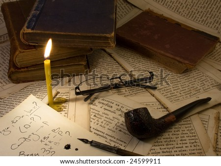 Pipe Smoking,candle, Glasses, old books ink pen on the old book pages - stock photo