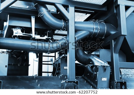 pipe system to a modern plant - stock photo